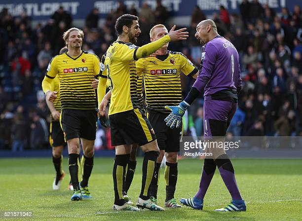 Watford players surround Heurelho Gomes of Watford following his two penalty saves during the Barclays Premier League match between West Bromwich...
