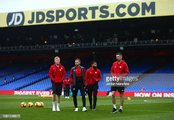 Watford players walk on the pitch prior to the Premier League match between Crystal Palace and Watford FC at Selhurst Park on January 12 2019 in...