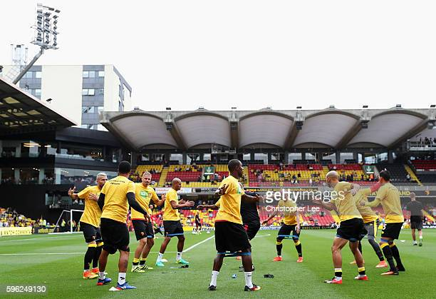 Watford players warm up during the Premier League match between Watford and Arsenal at Vicarage Road on August 27 2016 in Watford England