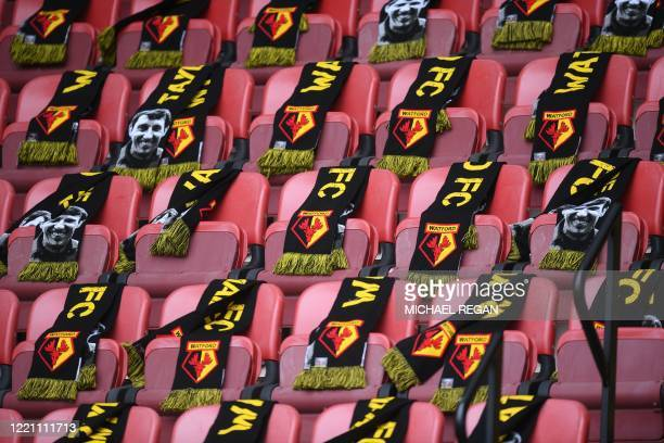 TOPSHOT Watford scarves are seen on the empty seats before kick off of the English Premier League football match between Watford and Leicester City...