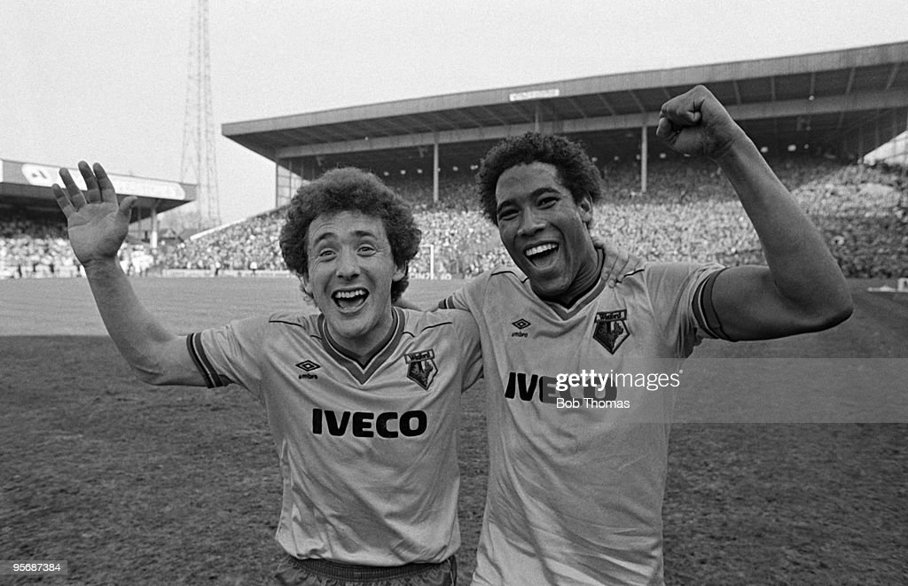 Watford skipper Wilf Rostron (left) with teammate John Barnes celebrate after their victory against Plymouth Argyle in their FA Cup Semi-Final match held at Villa Park, Birmingham on 14th April 1984. Watford won 1-0. (Bob Thomas/Getty Images).