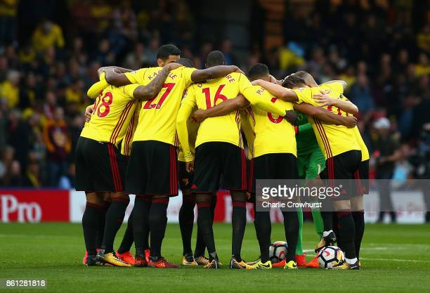 Watford stand together during the Premier League match between Watford and Arsenal at Vicarage Road on October 14 2017 in Watford England