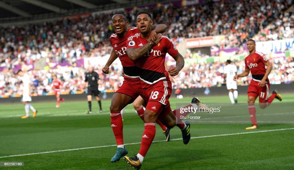 Watford striker Andre Gray (r) celebrates with Andre Carrillo after scoring the opening goal during the Premier League match between Swansea City and Watford at Liberty Stadium on September 23, 2017 in Swansea, Wales.