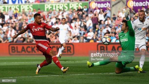Watford striker Andre Gray scores the opening goal during the Premier League match between Swansea City and Watford at Liberty Stadium on September...