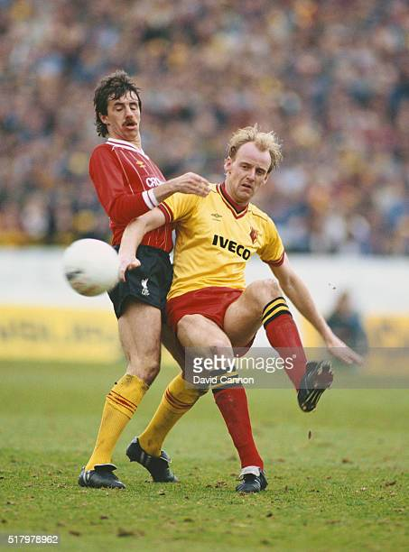 Watford striker George Reilly is challenged by Liverpool defender Mark Lawrenson during a League Division One match between Watford and Liverpool at...