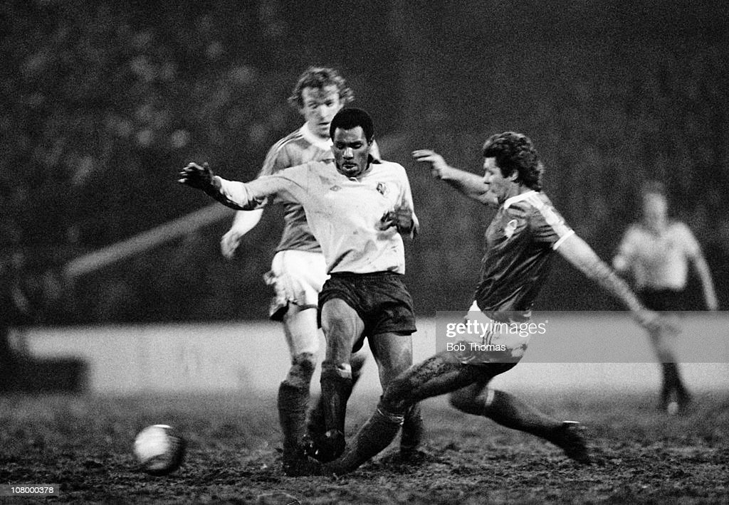 Watford striker Luther Blissett is tackled by David Needham (right) and Ian Bowyer of Nottingham Forest during the League Cup Semi-Final 1st leg at the City Ground in Nottingham, 17th January 1979. Nottingham Forest won 3-1.
