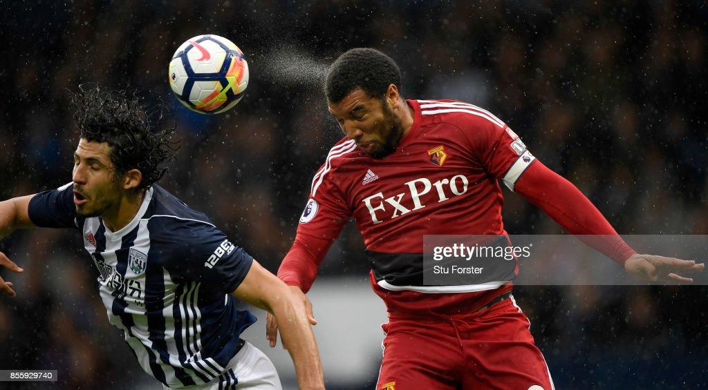 Watford striker Troy Deeney (r) beats Ahmed Hegazi to the ball during the Premier League match between West Bromwich Albion and Watford at The Hawthorns on September 30, 2017 in West Bromwich, England.