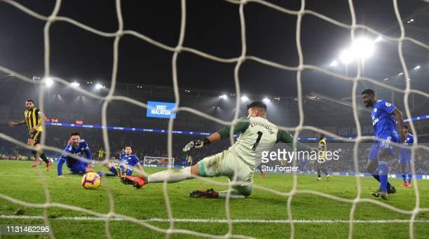 Watford striker Troy Deeney scores the 5th Watford goal past Neil Etheridge during the Premier League match between Cardiff City and Watford FC at...