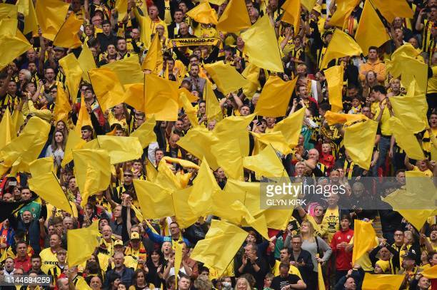 Watford supporters prepare for the English FA Cup final football match between Manchester City and Watford at Wembley Stadium in London on May 18...