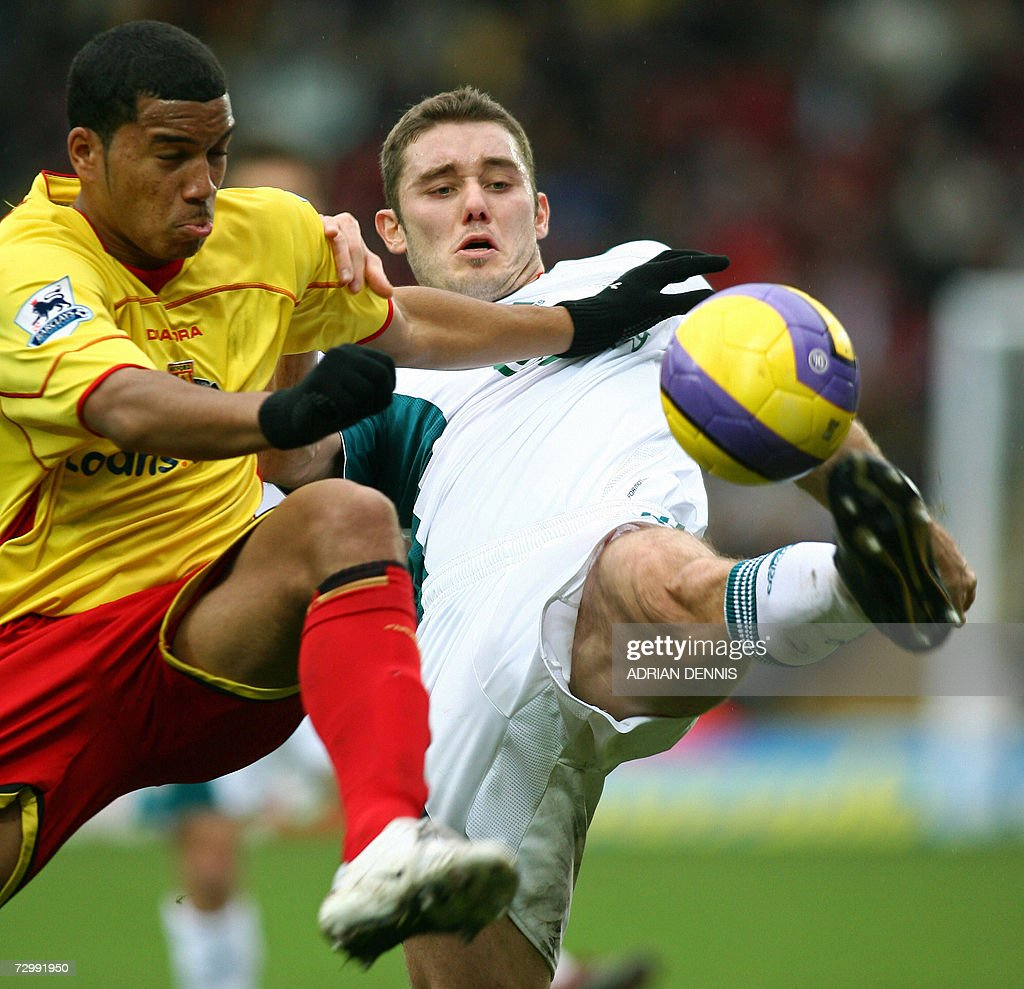 Liverpool's Fabio Aurelio (R) competes for the ball against Watford's Adrian Mariappa (L) during the Premiership football match at Vicarage Road in Watford 13 January 2007. Liverpool's Peter Crouch scored twice, with Liverpool winning 3-0. AFP PHOTO ADRIAN DENNIS Mobile and website uses of domestic English football pictures subject to subscription of a license with Football Association Premier League (FAPL) tel : +44 207 298 1656. For newspapers where the football content of the printed and electronic versions are identical, no licence is necessary.