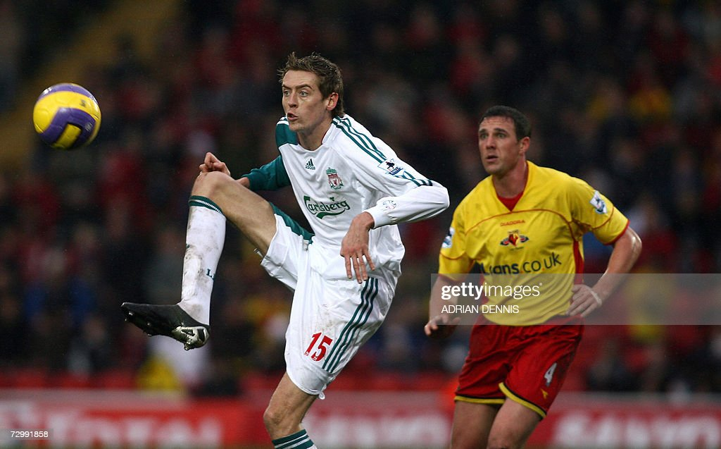 Liverpool's Peter Crouch (L) keeps his eye on the ball in front of Watford's Malky Mackay during the Premiership football match at Vicarage Road in Watford, 13 January 2007. Crouch scored twice in the game with Liverpool winning 3-0. AFP PHOTO ADRIAN DENNIS Mobile and website uses of domestic English football pictures subject to subscription of a license with Football Association Premier League (FAPL) tel : +44 207 298 1656. For newspapers where the football content of the printed and electronic versions are identical, no licence is necessary.