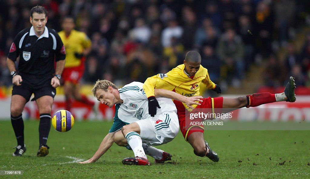 Liverpool's Sami Hyypia (C) competes for the ball against Watford's Ashley Young (R) under the eye of Mark Clattenburg (L) during the Premiership football match at Vicarage Road in Watford 13 January 2007. Liverpool's Peter Crouch scored twice in the game with Liverpool winning 3-0. AFP PHOTO ADRIAN DENNIS Mobile and website uses of domestic English football pictures subject to subscription of a license with Football Association Premier League (FAPL) tel : +44 207 298 1656. For newspapers where the football content of the printed and electronic versions are identical, no licence is necessary.