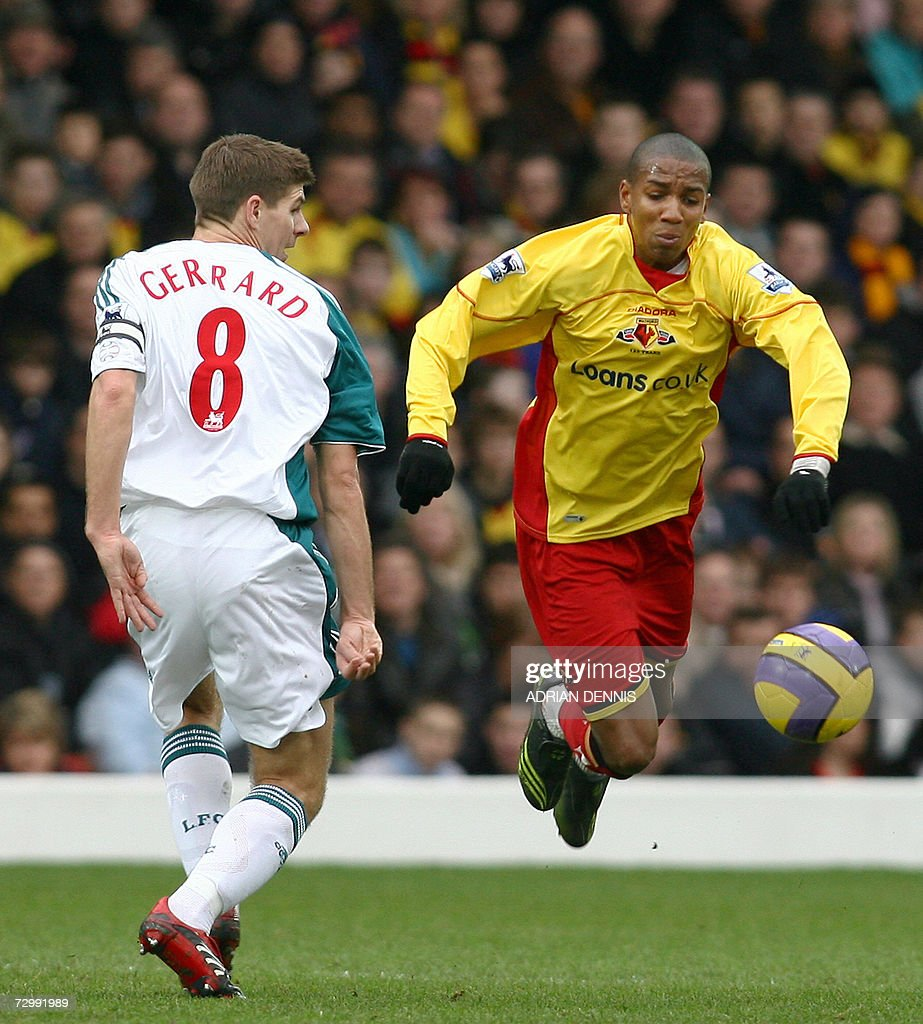 Liverpool's Steven Gerrard (C) competes for the ball against Watford's Ashley Young (R) during the Premiership football match at Vicarage Road in Watford 13 January 2007. Liverpool won the game 3-0. Ashley Young has recently been linked with a big money transfer away from Watford. AFP PHOTO ADRIAN DENNIS Mobile and website uses of domestic English football pictures subject to subscription of a license with Football Association Premier League (FAPL) tel : +44 207 298 1656. For newspapers where the football content of the printed and electronic versions are identical, no licence is necessary.