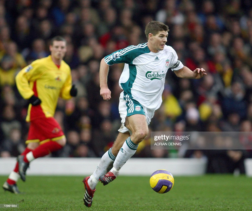 Liverpool's Steven Gerrard (C) runs with the ball through the midfield against Watford during the Premiership football match at Vicarage Road in Watford 13 January. Liverpool's Peter Crouch scored twice, with Liverpool winning 3-0. AFP PHOTO ADRIAN DENNIS Mobile and website uses of domestic English football pictures subject to subscription of a license with Football Association Premier League (FAPL) tel : +44 207 298 1656. For newspapers where the football content of the printed and electronic versions are identical, no licence is necessary.