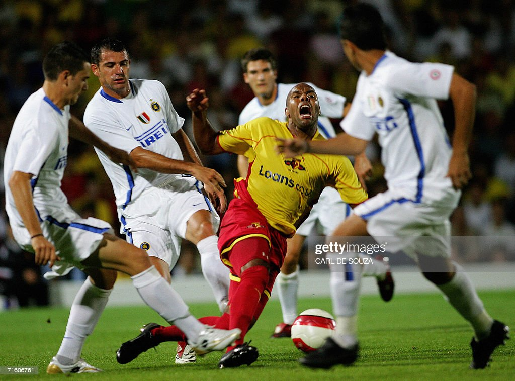Watford's Marlon King is tackled by Inter Milan defenders during their friendly match at home to Watford, 08 August 2006.