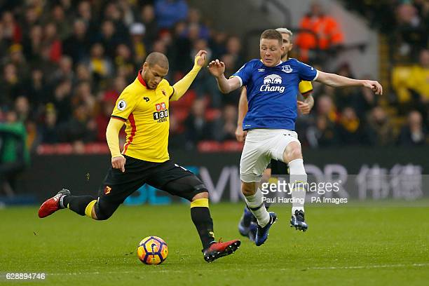 Watford's Adlene Guedioura and Everton's James McCarthy battle for the ball during the Premier League match at Vicarage Road Watford