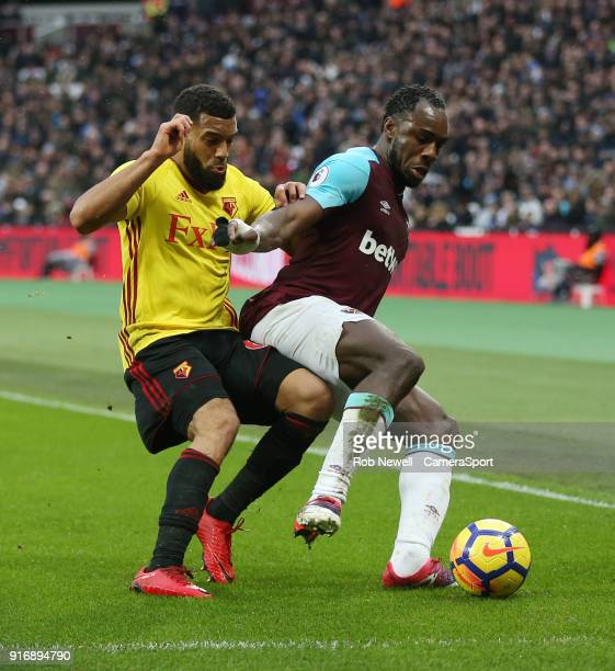 Watford's Adrian Mariappa and West Ham United's Michail Antonio during the Premier League match between West Ham United and Watford at London Stadium...
