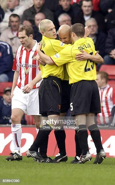 Watford's Alan Mahon celebrates his first half goal against Sunderland with team mates Heidar Helguson and Paul Devlin during the Nationwide Division...