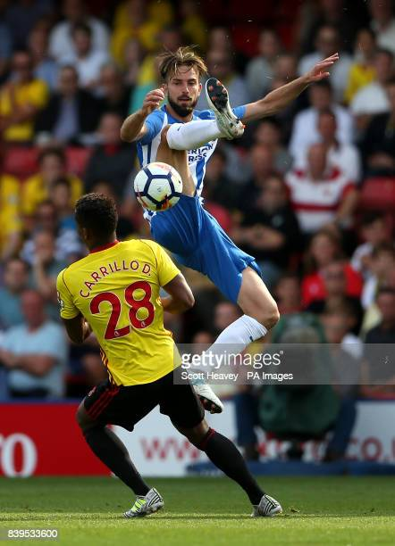 Watford's Andre Carillo and Brighton Hove Albion's Davy Propper battle for the ball during the Premier League match at Vicarage Road Watford