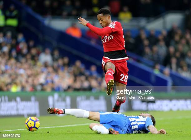 Watford's Andre Carrillo and Brighton Hove Albion's Markus Suttner battle for the ball during the Premier League match at the AMEX Stadium Brighton