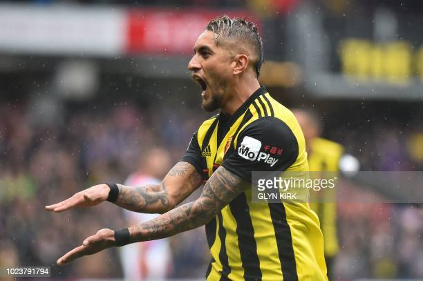 Watford's Argentinian midfielder Roberto Pereyra celebrates scoring the team's first goal during the English Premier League football match between...