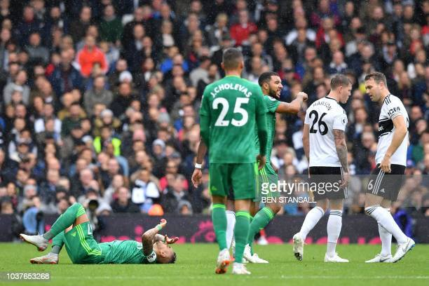 Watford's Argentinian midfielder Roberto Pereyra is injured from Fulham's English defender Alfie Mawson during the English Premier League football...