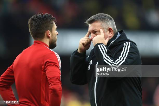 Watfords assistant coach Craig Shakespear discuses tactics with Watfords Kiko Femenia during the Premier League match between Watford and Aston Villa...
