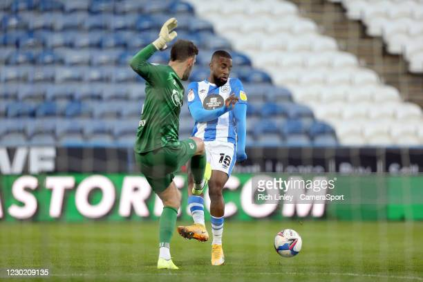 Watford's Ben Foster makes an errant pass under pressure from Huddersfield Town's Isaac Mbenza leading to an opening goal being scored by Fraizer...
