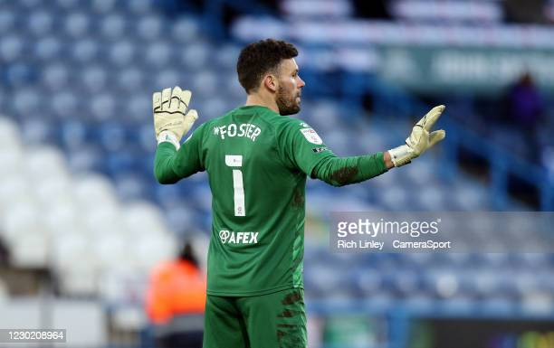 Watford's Ben Foster reacts after his early mistake led to an opening goal for Huddersfield Town during the Sky Bet Championship match between...