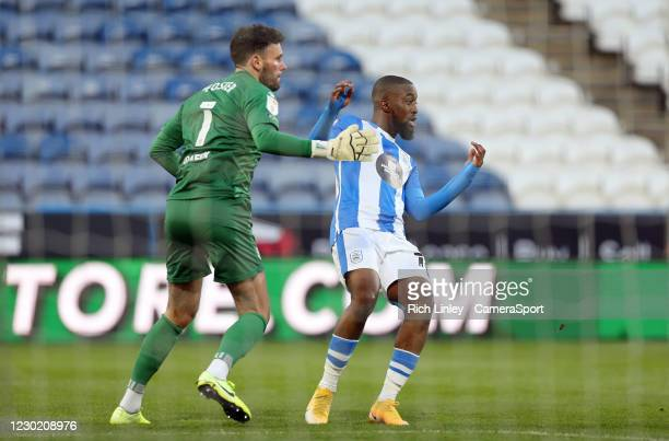 Watford's Ben Foster reacts as his errant pass under pressure from Huddersfield Town's Isaac Mbenza leads to an opening goal being scored by Fraizer...