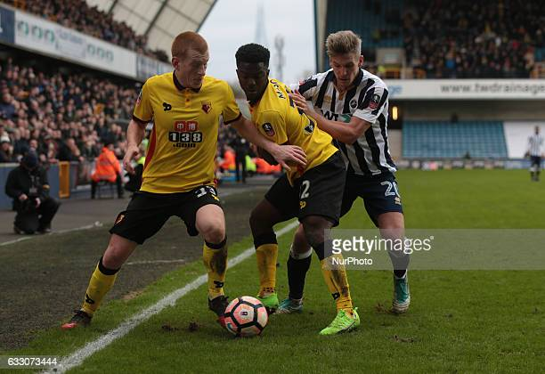 LR Watford's Ben Watson Millwall's Steve Morison holds of Watford's Brandon Mason during The Emirates FA Cup Fourth Round match between Millwall...