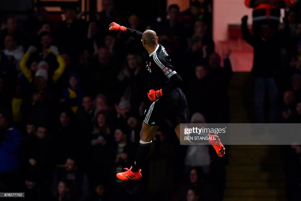 TOPSHOT - Watford's Brazilian goalkeeper Heurelho Gomes celebrates after Watford's Brazilian striker Richarlison de Andrade scored their second goal during the English Premier League football match between Watford and West Ham United at Vicarage Road Stadium in Watford, north of London on November 19, 2017. (Photo by Ben STANSALL / AFP) / RESTRICTED TO EDITORIAL USE. No use with unauthorized audio, video, data, fixture lists, club/league logos or 'live' services. Online in-match use limited to 75 images, no video emulation. No use in betting, games or single club/league/player publications. /