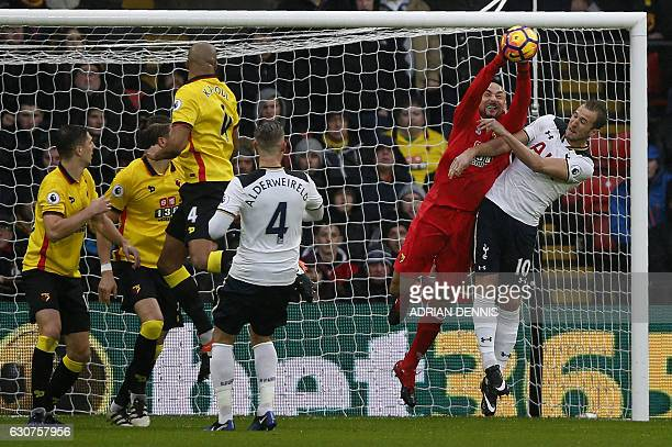 Watford's Brazilian goalkeeper Heurelho Gomes vies with Tottenham Hotspur's English striker Harry Kane during the English Premier League football...