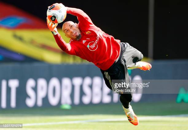 Watford's Brazilian goalkeeper Heurelho Gomes warms up ahead of the English Premier League football match between Watford and Manchester City at...