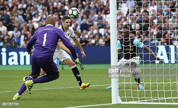 Watford's Brazilian goalkeeper Heurelho Gomes watches as West Ham United's English midfielder Michail Antonio scores his team's second goal during...