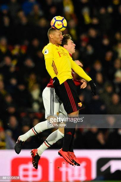 Watford's Brazilian striker Richarlison de Andrade beats Manchester United's Swedish defender Victor Lindelof in the air during the English Premier...