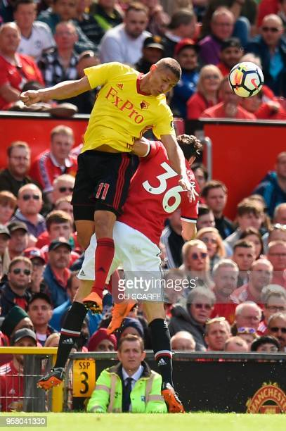 Watford's Brazilian striker Richarlison de Andrade beats Manchester United's Italian defender Matteo Darmian during the English Premier League...