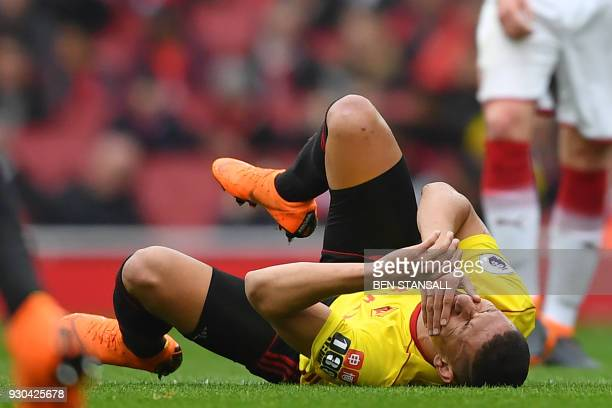 Watford's Brazilian striker Richarlison de Andrade falls to the floor during the English Premier League football match between Arsenal and Watford at...