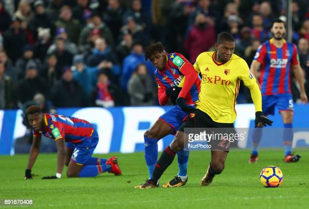 Watford's Christian Kabasele holds of Crystal Palace's Wilfried Zaha during Premier League match between Crystal Palace and Watford at Selhurst Park...