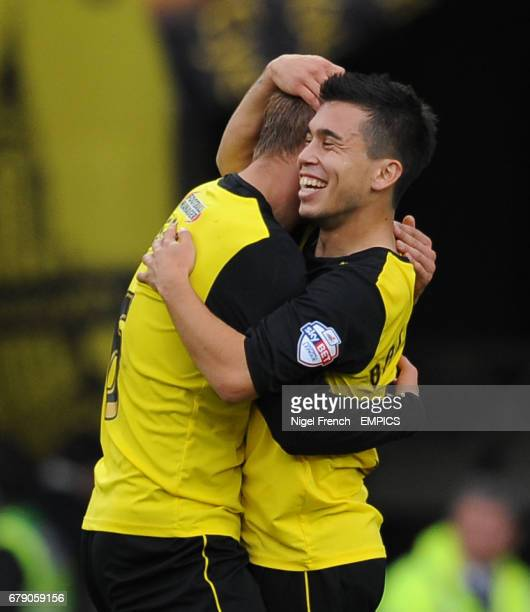 Watford's Cristian Battocchio celebrates with Joel Ekstrand after the game against Wigan Athletic