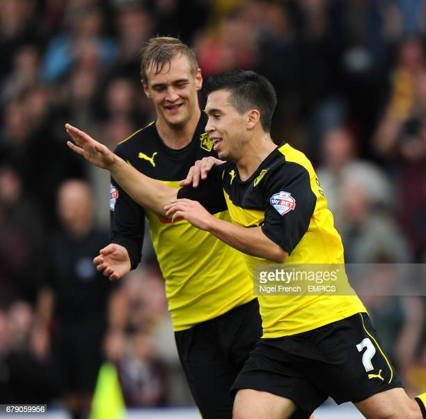 Watford's Cristian Battocchio celebrates with Joel Ekstrand after scoring the opening goal of the game against Wigan Athletic.