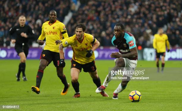 Watford's Daryl Janmaat and West Ham United's Michail Antonio during the Premier League match between West Ham United and Watford at London Stadium...