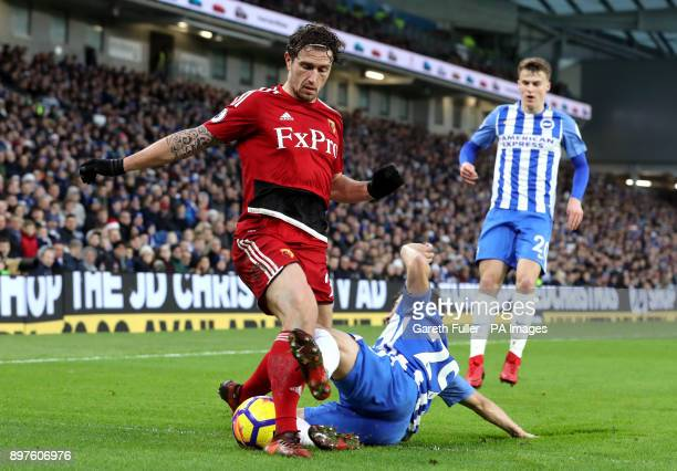Watford's Daryl Janmaat challenged by Brighton Hove Albion's Markus Suttner during the Premier League match at the AMEX Stadium Brighton