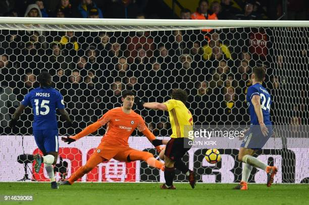 Watford's Dutch defender Daryl Janmaat scores past Chelsea's Belgian goalkeeper Thibaut Courtois during the English Premier League football match...