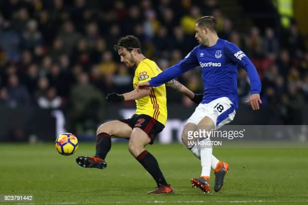 Watford's Dutch defender Daryl Janmaat vies with Everton's Icelandic midfielder Gylfi Sigurdsson during the English Premier League football match...