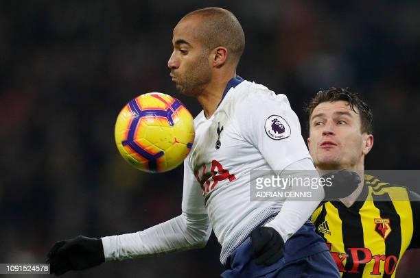 Watford's Dutch defender Daryl Janmaat vies with Tottenham Hotspur's Brazilian midfielder Lucas Moura during the English Premier League football...