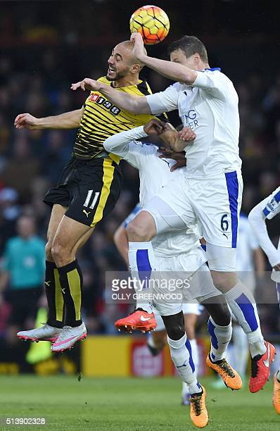 Watford's Dutchborn Moroccan midfielder Nordin Amrabat vies with Leicester City's German defender Robert Huth during the English Premier League...