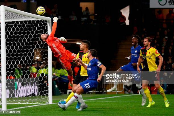 Watford's English goalkeeper Ben Foster makes a save during the English Premier League football match between Watford and Chelsea at Vicarage Road...