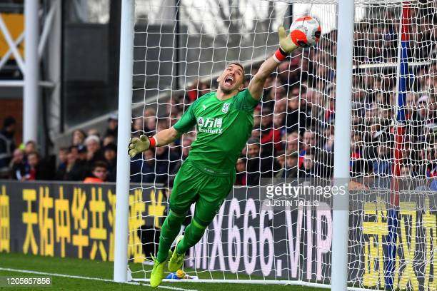 Watford's English goalkeeper Ben Foster makes a save during the English Premier League football match between Crystal Palace and Watford at Selhurst...