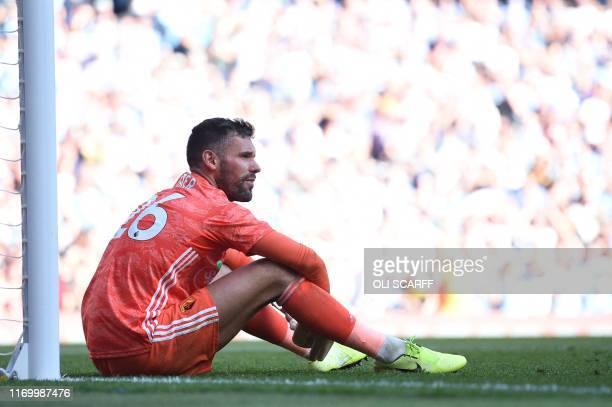 Watford's English goalkeeper Ben Foster reacts after Manchester City's Portuguese midfielder Bernardo Silva scores the team's seventh goal during the...